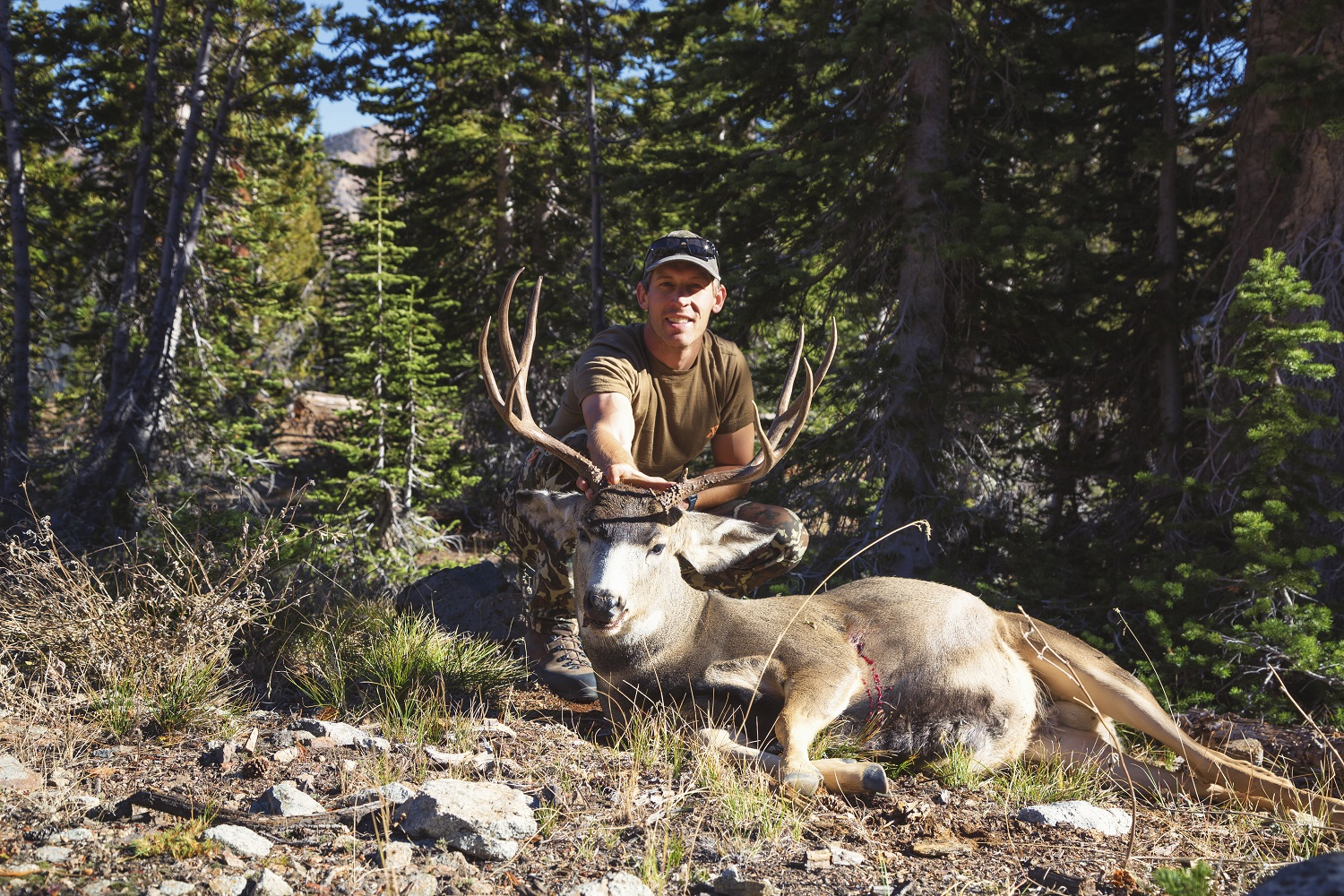 Brad Brooks of Argali with a mule deer buck