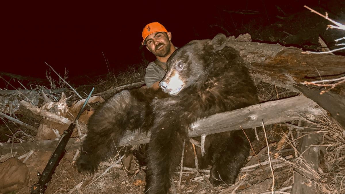 Jaden Bales with his 2020 spring black bear that he harvested in wyoming